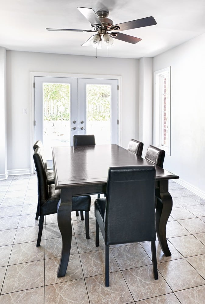 dining set and a ceiling fan